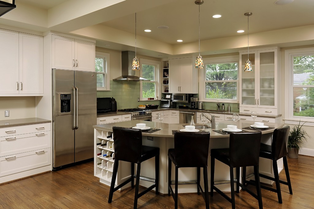Ahmann llc for Different shaped kitchen island designs with seating